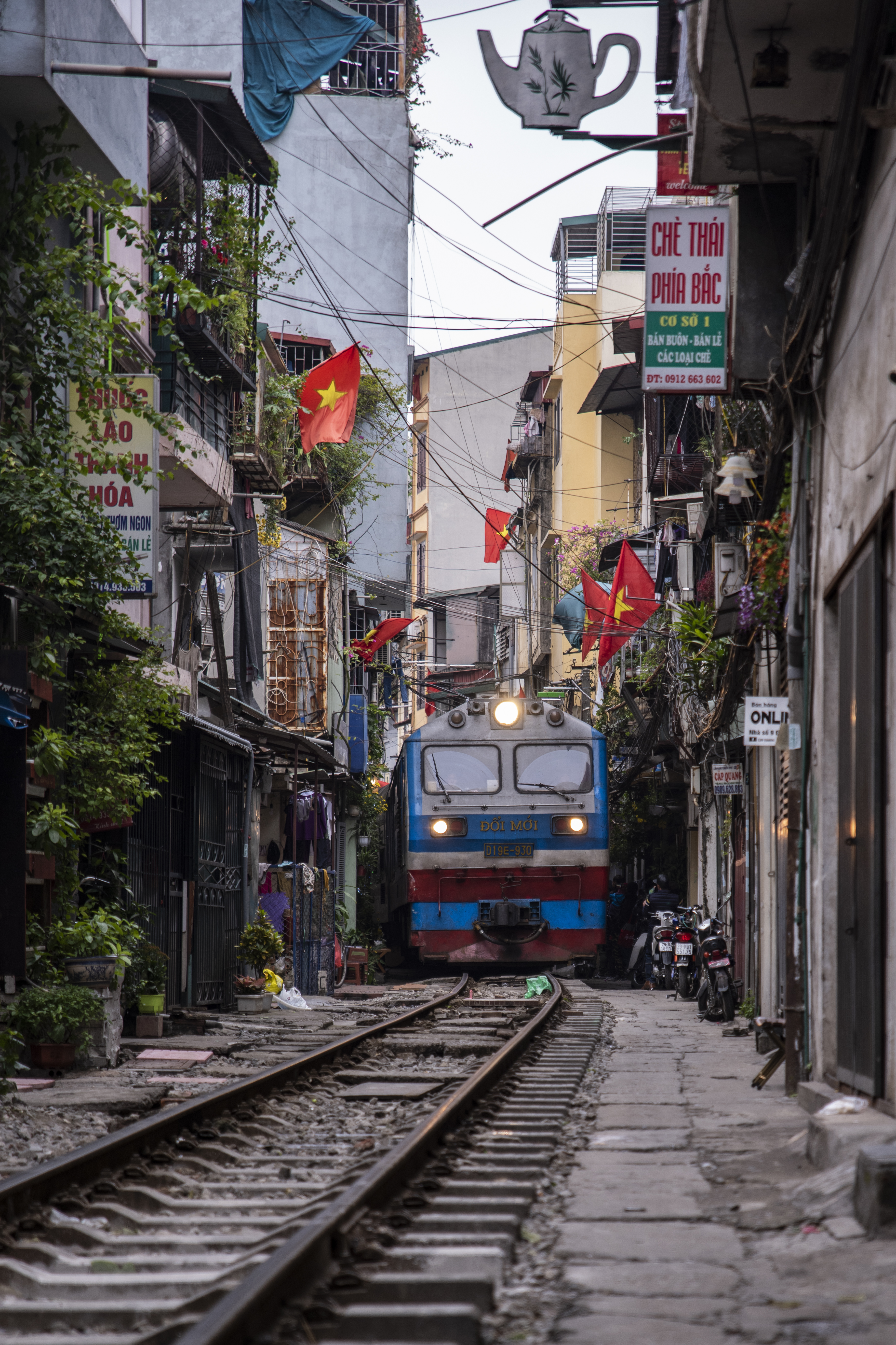 Train on a narrow street